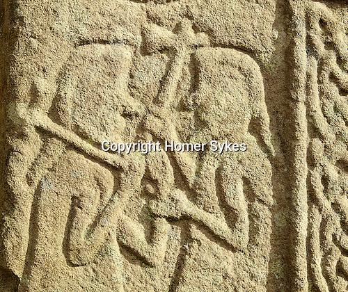 The St Fergus Manse Cross Slab. The Manse Pictish Standing Stone, Glamis, Angus, Scotland. Detail  Pictish Symbol. Half Christian half pagan found in the garden of the manse next to St Fergus's Kirk.  Celtic Britain published by Orion