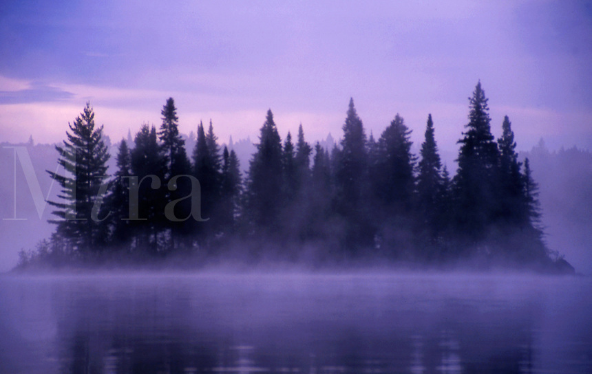 Mist rising around an island in the Algonquin Provincial Park, Ontario, Canada.