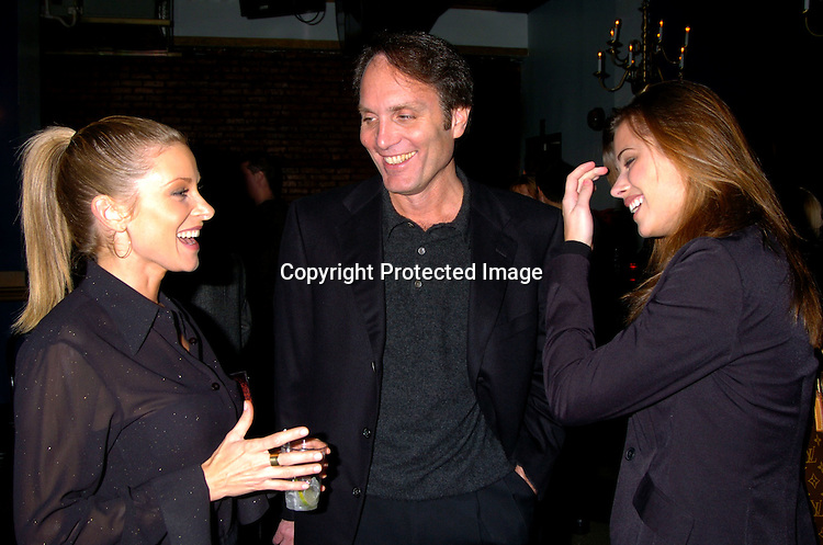 Cady McClain, Chris Goutman and Peyton List..at The As The World Turns Christmas Party on      December 5, 2003 at Club New York in New York City. Photo by Robin Platzer, Twin Images