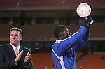 27 October 2007: Kansas City's Eddie Johnson holds up his team MVP award as Technical Director Peter Vermes applauds. The Kansas City Wizards defeated Club Deportivo Chivas USA 1-0 in the first leg of their Major League Soccer Western Conference Semifinal playoff series at Arrowhead Stadium in Kansas City, Missouri.