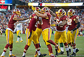 Washington Redskins defense celebrates after forcing a safety early in the first quarter against the Green Bay Packers in an NFC Wild Card game at FedEx Field in Landover, Maryland on Sunday, January 10, 2016. Pictured, from left to right: Washington Redskins cornerback Quinton Dunbar (47), defensive end Preston Smith (94), who forced the safety, inside linebacker Will Compton (51), inside linebacker Mason Foster (54), and defensive end Chris Baker (92).<br /> Credit: Ron Sachs / CNP