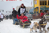 Anna Berington and team leave the ceremonial start line at 4th Avenue and D street in downtown Anchorage during the 2013 Iditarod race. Photo by Jim R. Kohl/IditarodPhotos.com