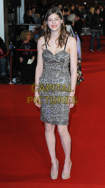 Amber Anderson.'W.E.' UK film premiere at Odeon cinema, Kensington, London, England..11th January 2011.full length silver beige grey gray leopard print dress shoes platform  .CAP/BEL.©Tom Belcher/Capital Pictures.