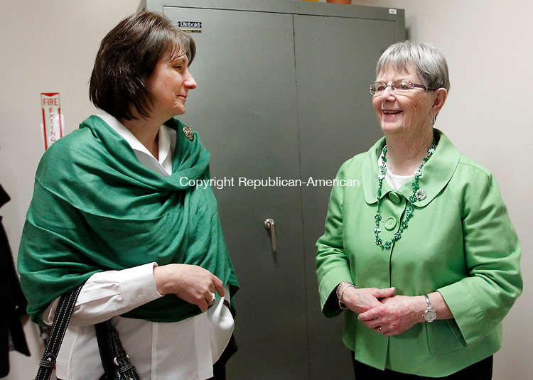 Winsted, CT-15 March 2012-031512CM06-  Joan Nelligan (right) chats with her daughter-in-law Peg Nelligan of Colebrook Thursday afternoon at the Winsted Town Hall.  Joan and her husband, Frank were named Mayors of the day, an annual St. Patrick's Day tradition in town.  After the two were honored, a reception was held at the town hall.   Christopher Massa Republican-American