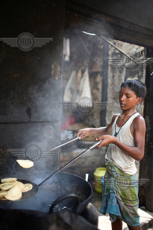 Children working in a roadside restaurant in the new market area of Kolkata.
