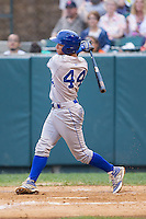 Marten Gasparini (44) of the Burlington Royals follows through on his swing against the Pulaski Mariners at Calfee Park on June 20, 2014 in Pulaski, Virginia.  The Mariners defeated the Royals 6-4. (Brian Westerholt/Four Seam Images)