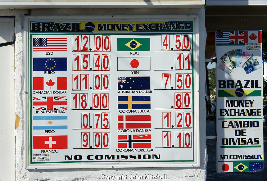 Current exchange rates 2013 at an exchange booth or casa de cambio in downtown, Cancun, Quintana Roo, Mexico.