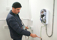 Student electrician testing a circuit, Able Skills, Dartford, Kent.