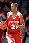 MADISON, WI - OCTOBER 24: Guard Morris Cain #21 of the Wisconsin Badgers handles the ball during the red/white scrimmage at the Kohl Center on October 24, 2006 in Madison, Wisconsin. The White team defeated the Red team 72-69. (Photo by David Stluka)