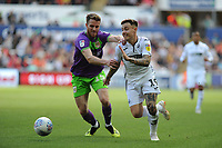 Marley Watkins of Bristol City vies for possession with Barrie McKay of Swansea City during the Sky Bet Championship match between Swansea City and Bristol City at the Liberty Stadium, Swansea, Wales, UK. Saturday 25 August 2018
