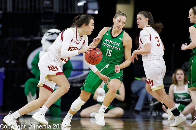SIOUX FALLS, SD - MARCH 10: Sydney Mech #25 from Denver dribbles around the arc in front of Faith Dooley #15 from North Dakota at the 2019 Summit League Basketball Tournament at the Denny Sanford Premier Center in Sioux Falls. (Photo by Dick Carlson/Inertia)