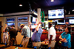 Members of the national and international press ready to document diners watching Tiger Woods' televised press conference at Somewhere in Augusta Bar, just down the road from where it is being broadcasted live at The Augusta National Golf Course in Augusta, Georgia April 15, 2010.