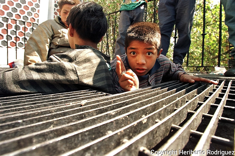 Street children gather around to sniff thinner in Mexico City's Central Park. Due to economic crisis and familiar violence, hundred of children leave their families and survive on streets. Photo by Heriberto Rodriguez