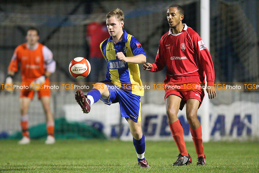 Jack Barry of Romford shields the ball from Karl Blake of Ilford - Romford vs Ilford - Ryman League Division One North Football at Mill Field, Aveley FC - 27/09/11 - MANDATORY CREDIT: Gavin Ellis/TGSPHOTO - Self billing applies where appropriate - 0845 094 6026 - contact@tgsphoto.co.uk - NO UNPAID USE.