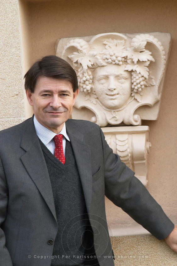 General Manager Pierre-Henri (Henry) Gagey posing in front of a statue bust depicting Bacchus Baccus, Maison Louis Jadot, Beaune Côte Cote d Or Bourgogne Burgundy Burgundian France French Europe European