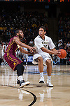 Miles Overton (20) of the Wake Forest Demon Deacons is guarded by Andre Hollins (1) of the Minnesota Golden Gophers during first half action at the LJVM Coliseum on December 2, 2014 in Winston-Salem, North Carolina.  The Golden Gophers defeated the Demon Deacons 84-69. (Brian Westerholt/Sports On Film)