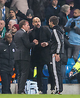 Celtic Manager Brendan Rogers tries to shake hands with Manchester City Manager (Head Coach) Josep Guardiola as he carry on talking with somebody else during the UEFA Champions League GROUP match between Manchester City and Celtic at the Etihad Stadium, Manchester, England on 6 December 2016. Photo by Andy Rowland.