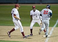 STANFORD, CA - April 19, 2013: Stanford first baseman Brian Ragira (11) celebrates the Cardinal victory at the end of the Stanford vs Arizona baseball game at Sunken Diamond in Stanford, California. Final score, Stanford 4, Arizona 3.