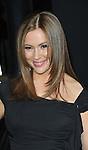 Alyssa Milano arriving at the New Year's Eve premiere, held at Grauman's Chinese theater December 5, 2011.
