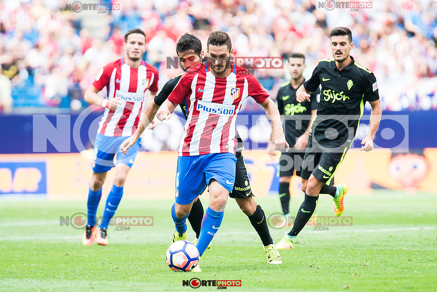 Atletico de Madrid's player Koke Resurrección and Sporting de Gijon's player Ignacio Cases during a match of La Liga Santander at Vicente Calderon Stadium in Madrid. September 17, Spain. 2016. (ALTERPHOTOS/BorjaB.Hojas) /NORTEPHOTO