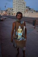 man begging for Lazarus on malecon, Havana