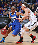 SIOUX FALLS, SD - MARCH 7: Kamilah Carter #4 from Fort Wayne drives against Kelly Stewart #15 of the University of South Dakota in the second half of their first round Summit League Championship Tournament game Saturday afternoon at the Denny Sanford Premier Center in Sioux Falls, SD. (Photo by Dick Carlson/Inertia)