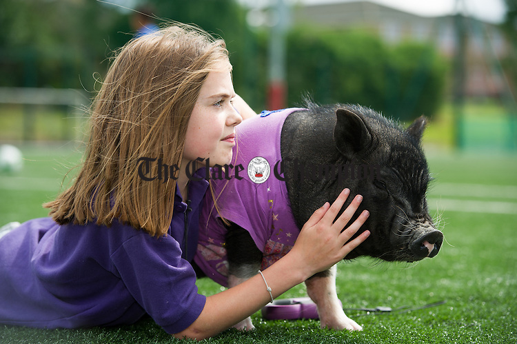 "Lorna Bermingham of the Burren Nature Sanctuary with her pet miniature pig ""Norman"" at Gort Show. Photograph by John Kelly."