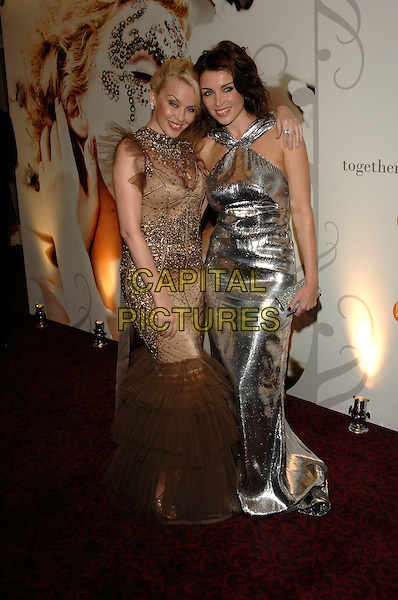 KYLIE MINOGUE & DANNII MINOGUE.MITS Awards, .Music Industry Trusts' Awards held at Grosvenor House Hotel, London, England , 29th October 2007..full length gold silver dress dresses sisters family  sequined net netting .CAP/PL.©Phil Loftus/Capital Pictures