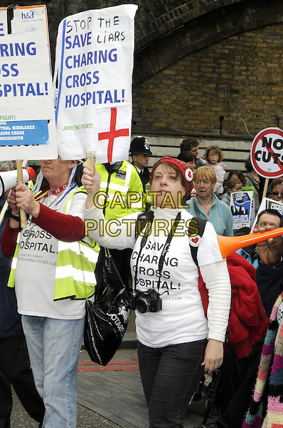 Demonstrators .Demonstration against privatisation of the National Health Service.Various groups including London residents, medical staff, trade unions protest against the Government's plans for hospital closures and the reduction of NHS services by private companies. London, UK, May 16th 2013..protest politics banners placards protestors .CAP/BK/PP.©Bob Kent/PP/Capital Pictures..