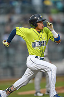 Shortstop Edgardo Fermin (10) of the Columbia Fireflies runs out a batted ball in a game against the Greenville Drive on Friday, May 25, 2018, at Spirit Communications Park in Columbia, South Carolina. Columbia won, 3-1. (Tom Priddy/Four Seam Images)