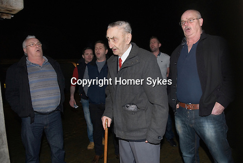 Bill Richards (91 yrs) leads a group of Wassailers who travel around the village of Curry Rivel Somerset on old New Years Eve, January 5th, singing a traditional wassailing song, and bidding the house holders &quot;... and a happy New Year&quot;, before being invited in for refreshment.  UK.  2016<br /> <br /> &pound;271-00 was collected for the local St Margaret's Hospice.<br /> <br /> Paul Willey, Bill Richards, Garry &quot;Budgie&quot; Eagle.