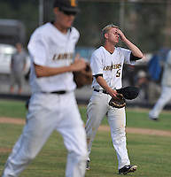 Sunny Hills' Garrett Molnar walks off the mound after escaping from a bases loaded situation and allowing 2 runs to score in the 6th inning. Sunny Hills went on to win 3-2.