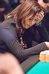 Jennifer Tilly contemplates calling Mark Newhouse.  She folded.