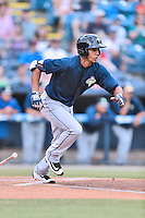 Columbia Fireflies third baseman J.C. Rodriguez (13) swings at a pitch during a game against the Asheville Tourists at McCormick Field on June 17, 2016 in Asheville, North Carolina. The Tourists defeated the Fireflies 6-2. (Tony Farlow/Four Seam Images)