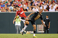Fabio (20) of Manchester United  and Fred (7) of the Philadelphia Union. Manchester United (EPL) defeated the Philadelphia Union (MLS) 1-0 during an international friendly at Lincoln Financial Field in Philadelphia, PA, on July 21, 2010.
