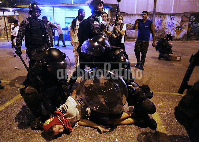A man is arrestd during riots on the streets of Rio to protest against official corruption and spending on next year's World Cup, Rio de Janeiro, Brasil, June 20, 2013. (Austral Foto/Léo Corrêa)