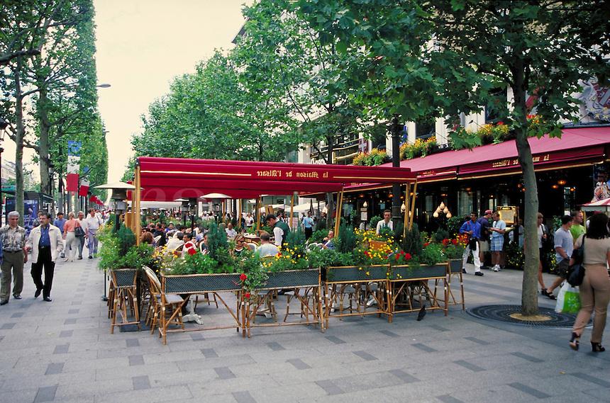 Champs Elysees in Paris, France. street scene, cafes, restaurants. Paris, France.