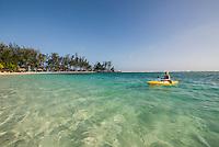 Honduras, Roatan Island, Fantasy Island Resort, Caribbean. Woman kayking on the ocean (Lisa).