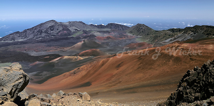Panorama view of cinder cones and lava flows in the crater of HALEAKALA NATIONAL PARK on Maui in Hawaii on an almost cloudless day
