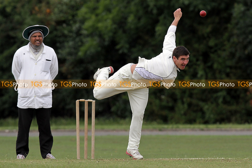 S Caruana in bowling action for Hornchurch Athletic - Hornchurch Athletic CC (fielding) vs Barking CC - Essex Cricket League - 09/07/11 - MANDATORY CREDIT: Gavin Ellis/TGSPHOTO - Self billing applies where appropriate - Tel: 0845 094 6026 - contact@tgsphoto.co.uk