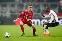Joshua Kimmich #32 (FC Bayern Muenchen) and Atiba Hutchinson #13 (Besiktas Istanbul), FC Bayern Muenchen vs. Besiktas Istanbul, Football, , Champions League, 20.02.2018 *** Local Caption *** © pixathlon<br /> Contact: +49-40-22 63 02 60 , info@pixathlon.de