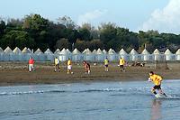 Partita di calcio sulla spiaggia del Lido di Venezia, in autunno.<br /> Autumn beach scene at Venice's Lido.<br /> UPDATE IMAGES PRESS/Riccardo De Luca