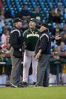 Baylor Bears head coach Steve Smith #34 argues a call with home plate umpire Danny Moscarro and third base umpire Danny Eldridge in game action versus the Rice Owls in the 2009 Houston College Classic at Minute Maid Park March 1, 2009 in Houston, TX.  The Owls defeated the Bears 8-3. (Photo by Brian Westerholt / Four Seam Images)