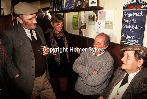 Local men  recite stories and poetry. Kings Head Laxfield Suffolk 1980s England.