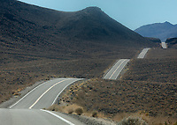A country roads winds its way through the Owens Valley of California