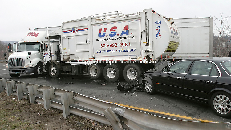 WATERBURY, CT 4/2/07- 040207BZ08- An accident involving a tractor trailer, Jaguar, garbarge truck, and another vehicle on Route 8 northbound closed the highway and caused traffic delays Monday.<br /> Jamison C. Bazinet Republican-American