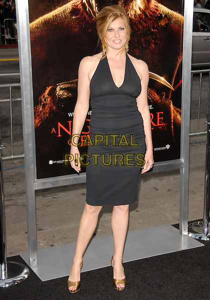 "CONNIE BRITTON.The Warner Bros. Pictures World Premiere of ""A Nightmare on Elm St."" held at The Grauman's Chinese Theatre in Hollywood, California, USA..April 27th, 2010.full length dress black halterneck gold shoes .CAP/RKE/DVS.©DVS/RockinExposures/Capital Pictures."