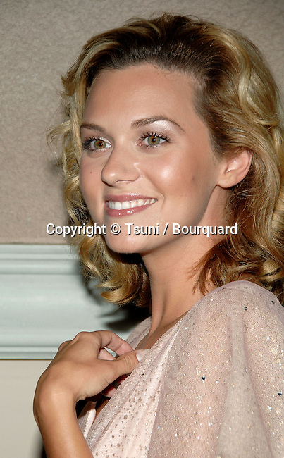 Hilarie Burton  arriving at the  CW television Critic Assocoation Summer Party at the Ritz Carlton Pasadena Los Angeles. July 17, 2006.<br /> headshot<br /> smile