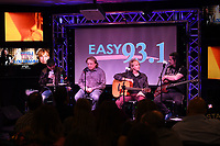 HOLLYWOOD, FL -  MARCH 08: DJ Mike Kruz, interviews Lou Gramm and Jeffrey Kollman, John Payne of Aisa during Easy Live at radio station Easy 93.1 on March 8, 2019 in Hollywood, Florida. Photo by Larry Marano &copy; 2019<br /> CAP/MPI04<br /> &copy;MPI04/Capital Pictures