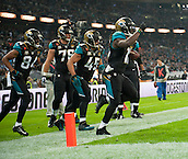 09.11.2014.  London, England.  NFL International Series. Jacksonville Jaguars versus Dallas Cowboys. Jaguars' Running Back Denard Robinson (#16) celebrates his touchdown.